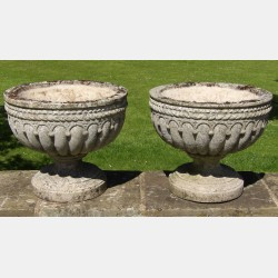 Pair of Weathered Stone Urns