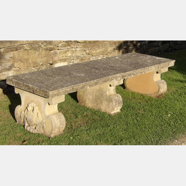 A vintage composition stone bench