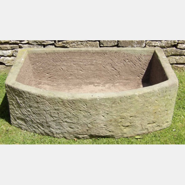 A Large Bow Fronted Stone Trough